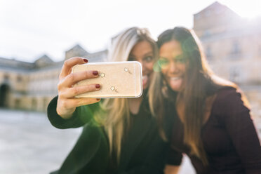 Two playful young women taking a selfie - MGOF02753