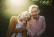 Portrait of two little girls at backlight - RAEF01630