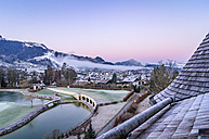 Austria, Tyrol, Kitzbuehel, view to the city at morning twilight - THAF01877