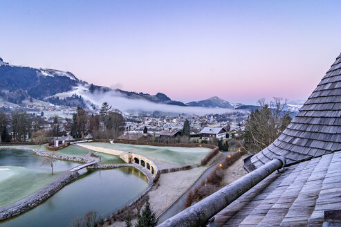 Austria, Tyrol, Kitzbuehel, view to the city at morning twilight - THAF01877