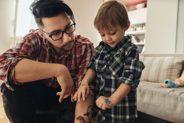 Proud son showing painted tattoo on his hand - ZEDF00496