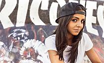 Portrait of brunette young woman wearing a baseball cap - MGO02787