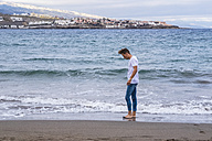 Spain, Tenerife, young man on the beach - SIPF01267