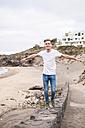 Young man balancing on a wall - SIPF01273