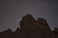 Spain, Tenerife, night shot with stars  over rocks at Teide National Park - DHCF00040