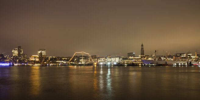 Germany, Hamburg, view to lighted city with Elbe River in the foreground - WIF03386