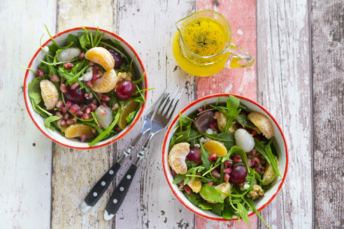 Two bowls with rocket, lychee, tangerine, cream cheese, walnuts, grapes and pomegranate seeds - SARF03114