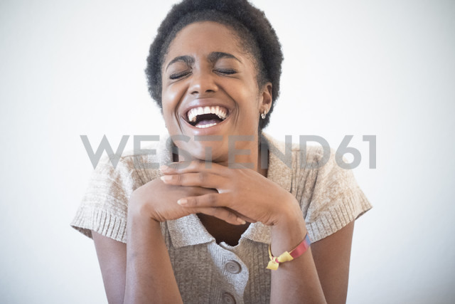 Portrait of laughing young woman with eyes closed - SIPF01288