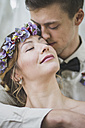 Close-up of bride and groom embracing - ASCF00694