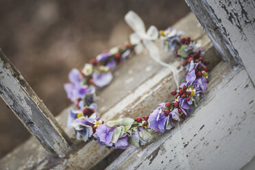 Floral wreath in weathered window frame - ASCF00700
