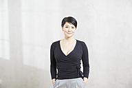 Portrait of confident woman - FMKF03474