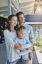 Happy family standing on terrace, embracing daughter - RORF00496