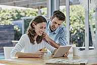 Senior couple doing online payment with credit card - RORF00520