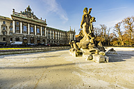 Germany, Munich, view to district court with neptune fountain in the foreground - THAF01878