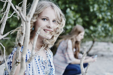 Portrait of smiling teenage girl in nature - RORF00527