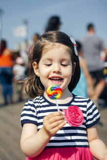USA, New York, Coney Island, happy little girl with lollipop - DAPF00545