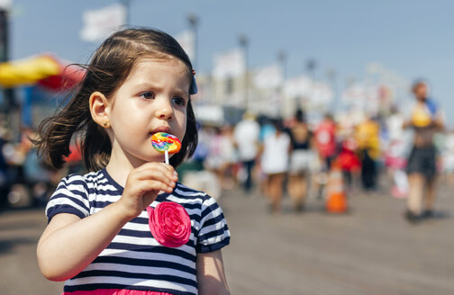 USA, New York, Coney Island, little girl with lollipop - DAPF00548