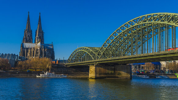 Germany, Cologne, view to Cologne Cathedral with Hohenzollern Bridge in the foreground - MHF00407