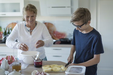 Grandson helping grandmother in kitchen - PAF01754