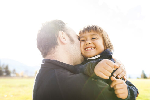 Father kissing his little son - VABF01029