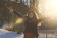 Portrait of happy young woman in winter - SARF03115