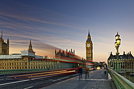 UK, London, Big Ben, Houses of Parliament and bus on Westminster Bridge at dusk - GFF00973