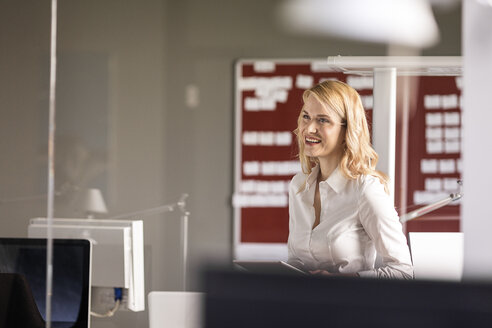 Smiling businesswoman in office - PESF00515