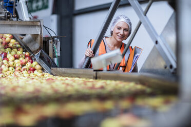 Female inspector in food processing plant - ZEF12429
