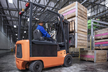 Man on forklift in factory hall - ZEF12441