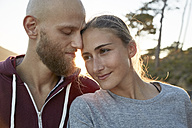Relaxed young couple in love at backlight - SRYF00238