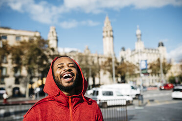 Laughing young man in the city - JRFF01174