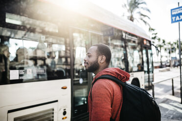 Young man in the city waiting for the bus - JRFF01177