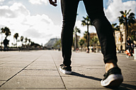 Legs of a man walking on pavement - JRFF01180