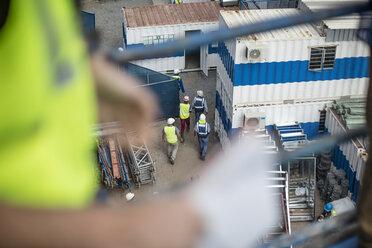 Top view of men walking on construction site - ZEF12460