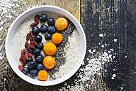 Bowl of porridge with milk, blueberries, chia, physalis and goji berries - ODF01483
