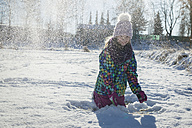 Girl throwing snow in the air - SARF03129