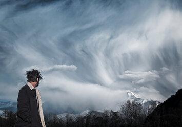 Austria, Mondsee, man watching clouds - WVF00791