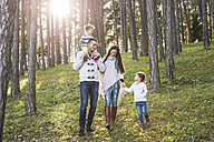 Happy family with two girls walking in forest - HAPF01295