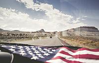 USA, Utah, American Flag lying on dashboard - EPF00280