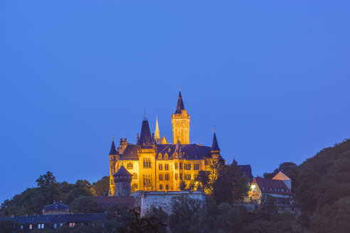 Germany, Saxony-Anhalt, Wernigerode, illuminated castle in the evening - PVC00958