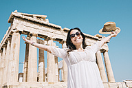 Greece, Athens, happy woman visiting the Parthenon temple on the Acropolis - GEMF01403