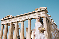 Greece, Athens, smiling woman visiting the Parthenon temple on the Acropolis - GEMF01409