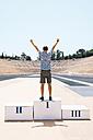 Greece, Athens, man on the podium celebrating in the Panathenaic Stadium - GEMF01418