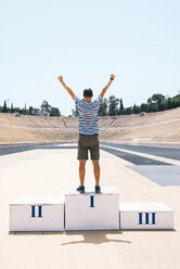 Greece, Athens, man on the podium celebrating in the Panathenaic Stadium - GEMF01418