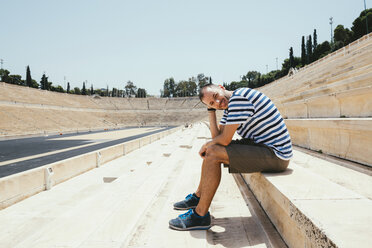 Greece, Athens, man sitting in the stands of the Panathenaic Stadium - GEMF01421