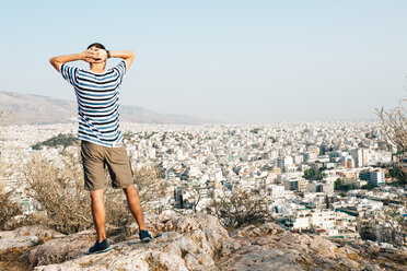 Greece, Athens, tourist looking at the city from Areopagus - GEMF01424