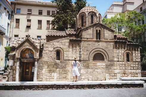 Greece, Athens, woman enjoying the architecture of Church of Panaghia Kapnikarea - GEMF01433