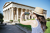 Greece, Athens, woman taking a cell phone pictire of the Hephaisteion in the Agora - GEMF01442