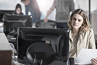 Young woman working on computer at desk in office - ZEF12533