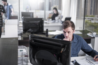 Man working on computer in office - ZEF12539
